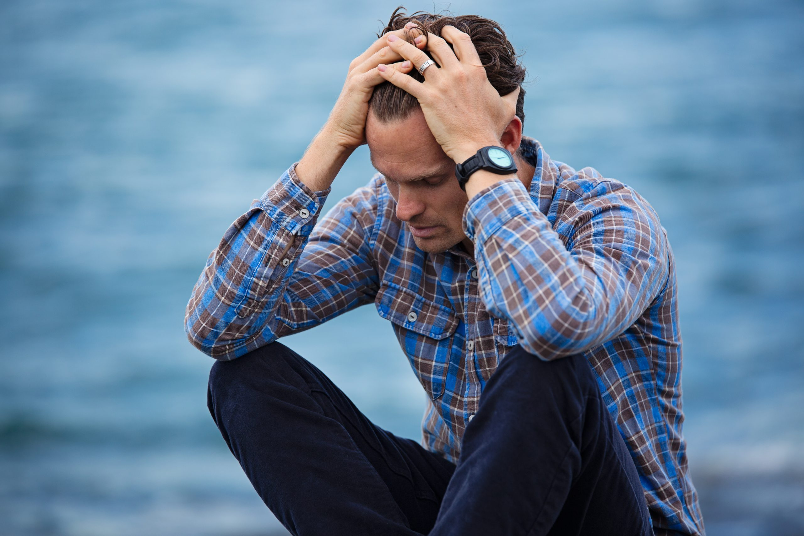 man worrying and feeling anxious